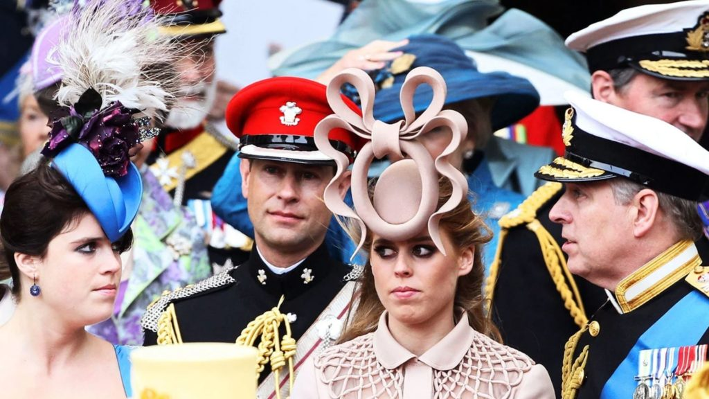 Women wearing fascinator hats.