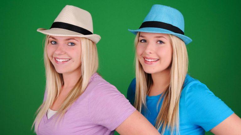 Women wearing fedora hats.